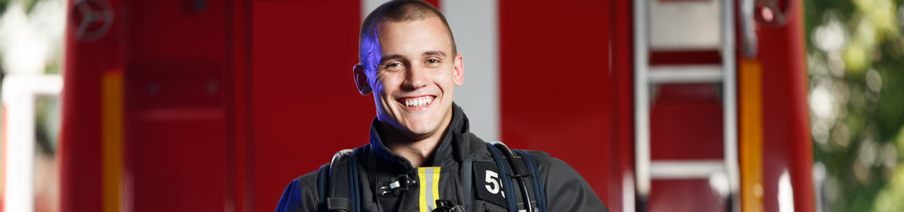 Firefighter Smiling - Fire Department Scheduling Software